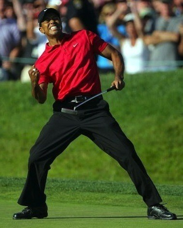Tiger Woods pumping his fist after sinking a putt on the 72nd hole of the 2008 US Open to tie Rocco Mediate for the lead.